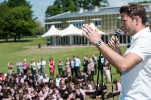 James Beattie addresses a large audience at The Blandford School in which he encouraged pupils to participate in sport.